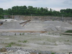 Processing site with various sizes of gypsum rock and fill available.